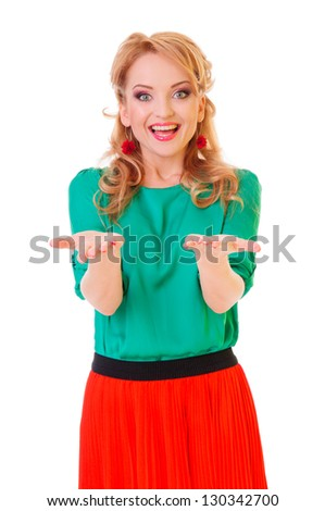 young excited woman standing happy smiling holding her hand showing something on the open palm, concept girl advertisement product, isolated over white background