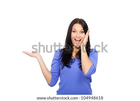 young excited woman standing happy smiling holding her hand showing something on the open palm with empty copy space, concept girl advertisement product, isolated over white background - stock photo
