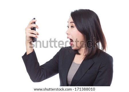 Young exciting business woman with smartphone. - stock photo