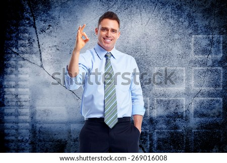 Young executive business man over blue background - stock photo