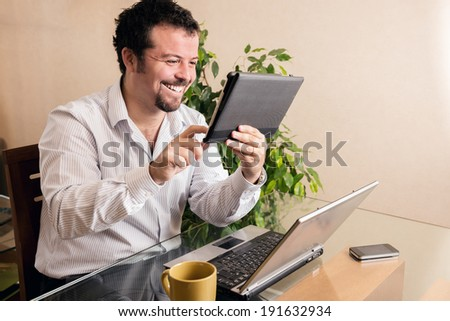 Young executive using technology - stock photo