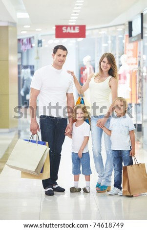 Young families with children in the shop - stock photo