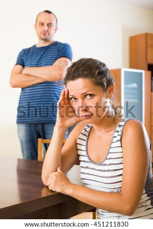 young family couple shouting while arguing indoors