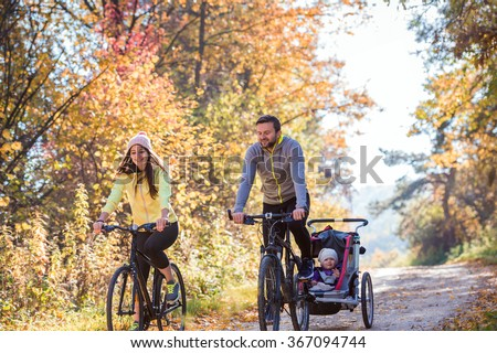 Young family cycling - stock photo