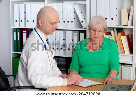 young family doctor examine a female senior
