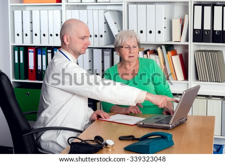 young family doctor in interview with a female senior