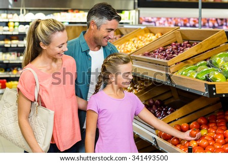 Young family doing some shopping at supermarket - stock photo