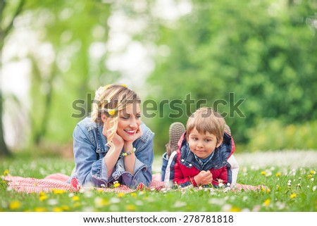 Young family enjoying spring while having a picnic in nature - stock photo