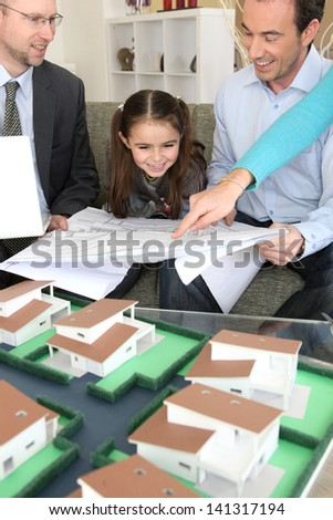 Young family excited about new house - stock photo