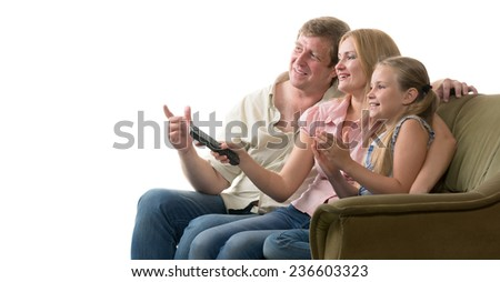 Young family: father, mother and daughter watching television sitting on the couch. All of them are very emotional. Isolated on white.