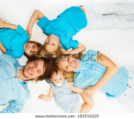 Young family from above - stock photo