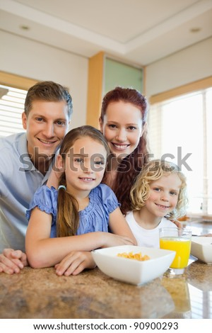 Young family having breakfast in the kitchen