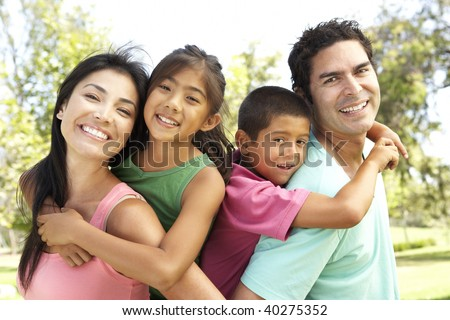 Young Family Having Fun In Park - stock photo