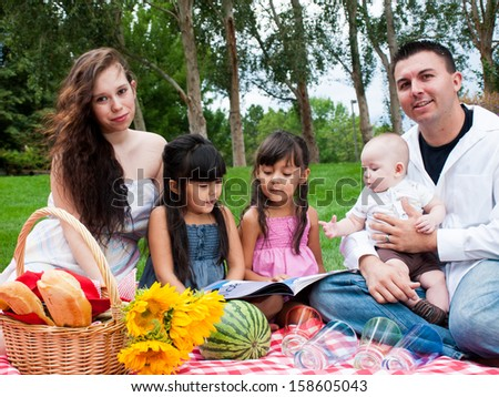 Young family having picnic at the park.