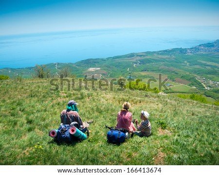 Young family hikers enjoys landscape