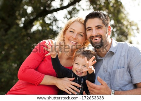 Young family in nature on sunny day