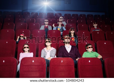 Young family in the 3d movie theater