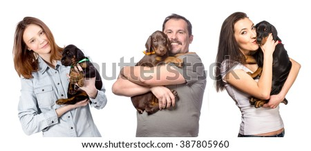 Young family is holding his sweet doberman puppies isolated on white background