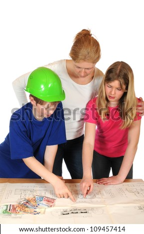 Young family is planning their own house - stock photo