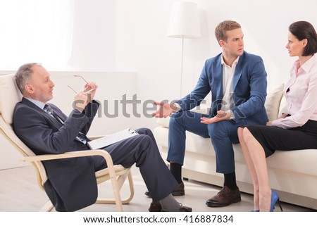Young family is visiting a psychotherapist - stock photo