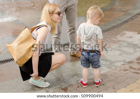 Young family is walking in the park during the summer