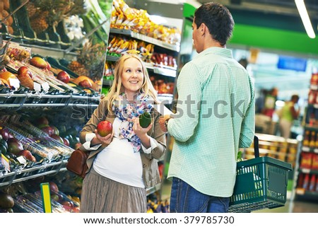 young family man and woman shopping in store - stock photo