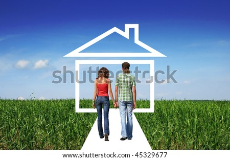 Young family meets half-way the dream  about house. Concept for real estate business and family home safety.