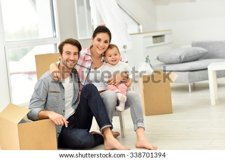 Young family moving into new home - stock photo