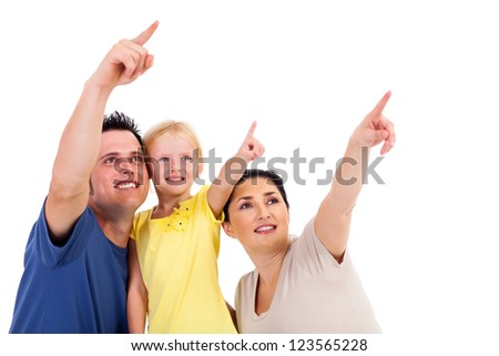 young family of three pointing at copyspace - stock photo