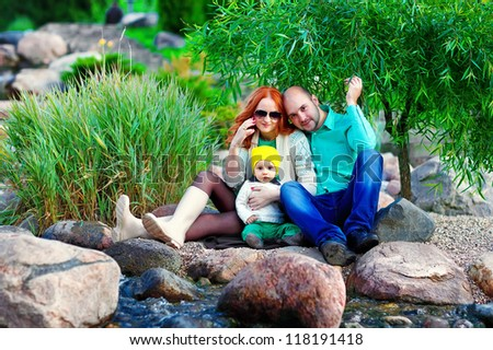 young family on a walk - stock photo