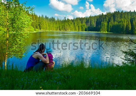 young family on summery trip - stock photo