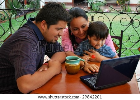 Young family on the computer together - stock photo