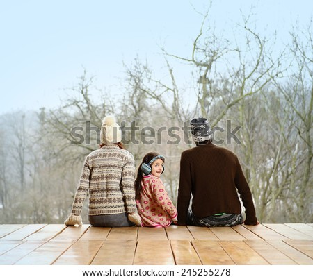 Young family on the porch of a country house. - stock photo