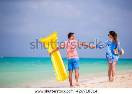 Young family on white beach at tropical vacation - stock photo