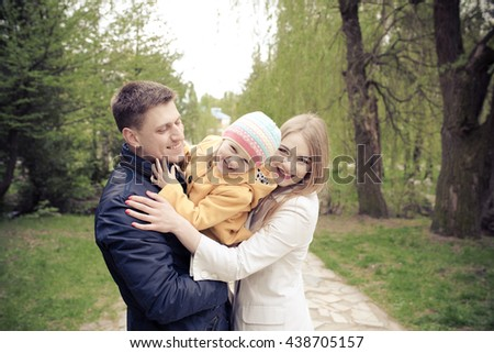 Young family relaxing in the park, emotion