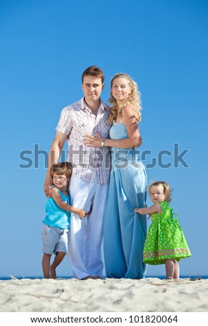 young family rests  at sea - stock photo