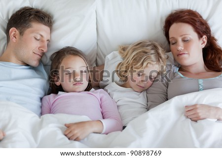 Young family taking a rest together - stock photo