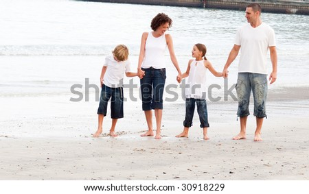 Young family walking on a beach