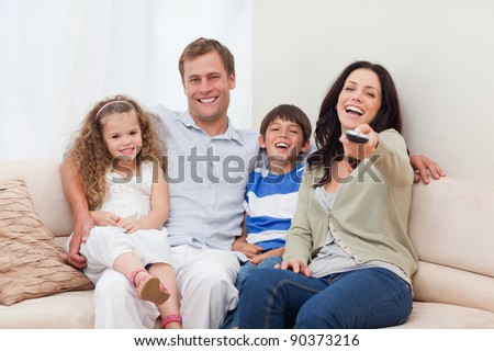 Young family watching comedy together
