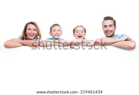 Young family with a banner - isolated on a white background - stock photo