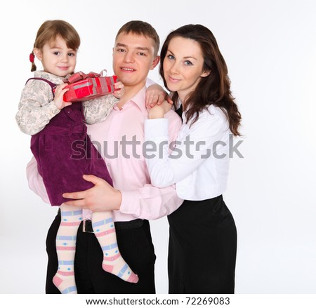 young family with a daughter holding a present