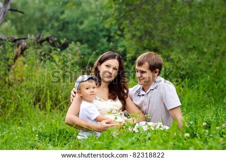 young family with a sun on the nature