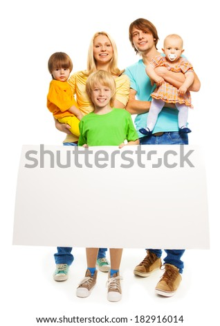 Young family with blank advertising banner - stock photo