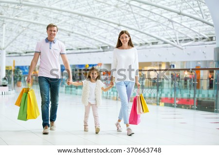 Young family with child in the store
