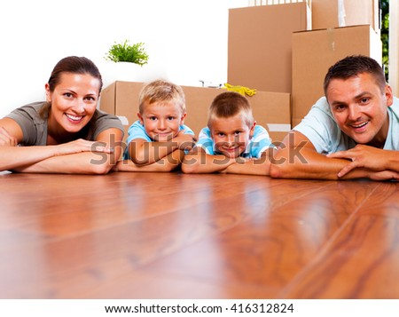 Young family with children happy to move into their new place.  - stock photo
