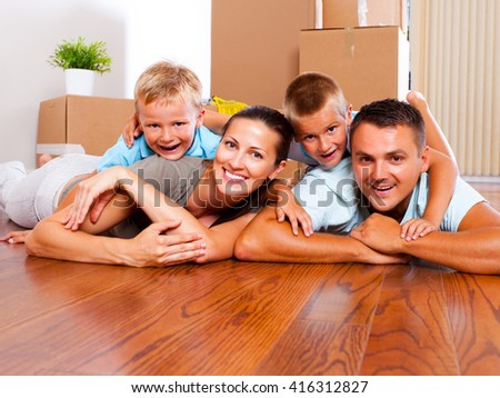 Young family with children happy to move into their new place.
