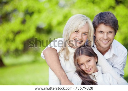Young family with children outdoors - stock photo