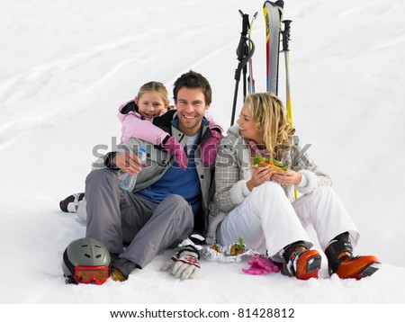 Young Family With Picnic On Ski Vacation - stock photo