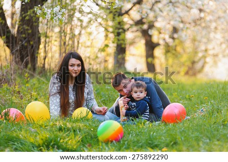 young family with son in the garden - stock photo