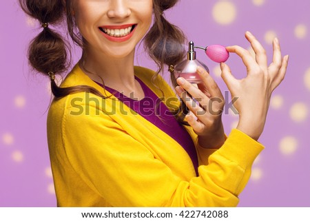Young fancy woman applying perfume, close up - stock photo